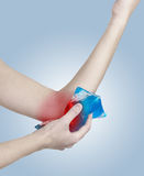 Ice on a swollen hurting elbow. Stock Photography