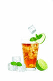 Ice Tea. Cold glass of iced tea with ice cubes, fresh mint and lime  on white background Stock Photos