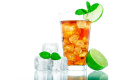 Ice Tea. Cold glass of iced tea with ice cubes, fresh mint and lime  on white background Stock Photo