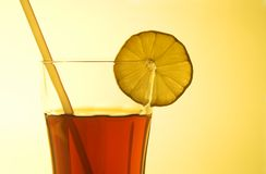 Ice tea. Glass of icetea on gold background stock image