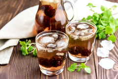 Ice tea with berry and fresh mint in glasses Wooden background Stock Images