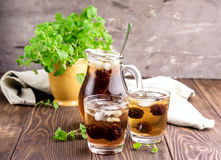 Ice tea with berry and fresh mint in glasses Wooden background Royalty Free Stock Photos