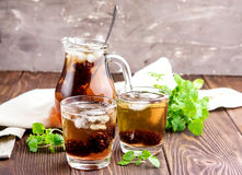Ice tea with berry and fresh mint in glasses Wooden background Royalty Free Stock Image