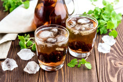 Ice tea with berry and fresh mint in glasses Wooden background Stock Photo