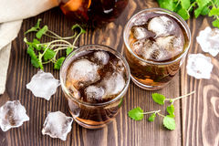 Ice tea with berry and fresh mint in glasses Wooden background Royalty Free Stock Photo