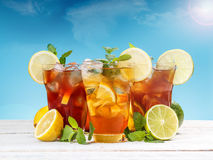 Ice tea. Fresh and cold ice tea with sliced lemon and mint Royalty Free Stock Image