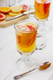 Ice tea with fruits. On a light background Royalty Free Stock Photography