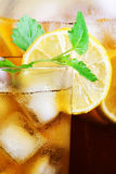 Ice tea in glass. Tasty, refreshing ice tea, with lemon. Macro Royalty Free Stock Image