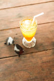 Ice tea and glasses on wooden table at beach Royalty Free Stock Image