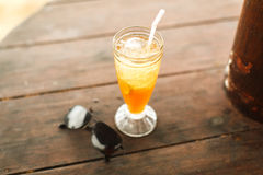 Ice tea and glasses on wooden table at beach Royalty Free Stock Photo