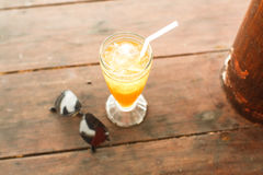 Ice tea and glasses on wooden table at beach Stock Photos