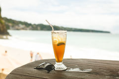 Ice tea and glasses on wooden table at beach Stock Photo