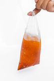 Ice tea on hand with isolated. Bag ice tea on hand of popular thai people with isolated background royalty free stock photo