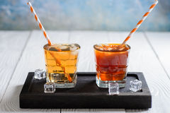 Ice Tea and Ice Coffee with ice cubes Royalty Free Stock Images