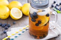 Ice tea with lemon and blueberries Royalty Free Stock Photography
