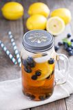 Ice tea with lemon and blueberries Stock Photo