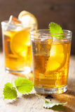 Ice tea with lemon and melissa Royalty Free Stock Photos