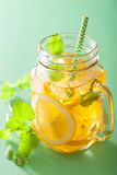 Ice tea with lemon and melissa in mason jars Royalty Free Stock Image