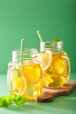 Ice tea with lemon and melissa in mason jars Stock Image