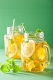 Ice tea with lemon and melissa in mason jars Stock Photo