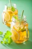 Ice tea with lemon and melissa in mason jars.  royalty free stock image