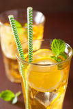 Ice tea with lemon and mint on dark rustic background Royalty Free Stock Images