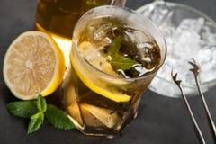 Ice tea with lemon and mint Stock Photos