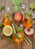 Ice tea with lemon, peach and mint Stock Photo