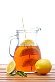 Ice tea with lemon pitcher Royalty Free Stock Photos