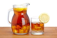 Ice tea with lemon pitcher Royalty Free Stock Images