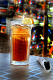 Ice tea with lemon. On table stock photos