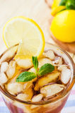 Ice tea with lemons and mint Stock Images