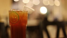 Ice tea with lime slice stock footage