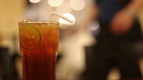 Ice tea with lime slice stock video