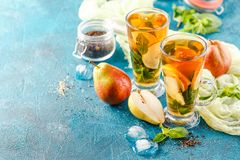 Ice tea with mint leaves and pear stock images