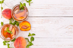 Ice tea with peach. Royalty Free Stock Photography