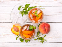 Ice tea with peach. Royalty Free Stock Images