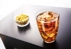 Ice tea & peanuts. Cold ice tea glass and some peanuts Royalty Free Stock Image