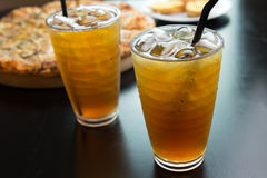 Ice tea with pizza Royalty Free Stock Image