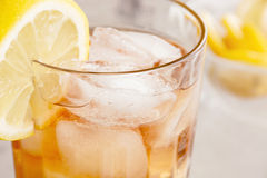 Ice Tea. Selective focus on a glass of iced tea with lemon slice Royalty Free Stock Photo