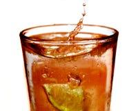 Ice Tea Splash. A high speed photo of lemon splashing into a glass of ice tea Stock Image