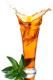 Ice tea with splash. And green leaves on white background Royalty Free Stock Photo