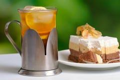 Ice tea with tart Royalty Free Stock Image