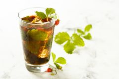 Ice tea with wild strawberry royalty free stock photography