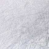 Ice texture on a skating rink. Ice background with marks from skating and hockey. Frozen white texture Stock Image