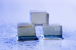 Ice. Three ice cubes with water Stock Photos