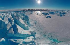 Ice tip of the iceberg, the age-old ice, the sun shines through. Close-up. sunny day. Antarctica stock image