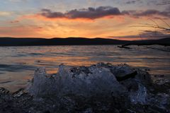 Through the ice towards sunset. stock photos