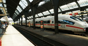 Ice train arrival in German train station Karlsruhe, Germany. KARSRUHE, GERMANY - CIRCA 2016: Ice Fast German train arrival in  Karlsruhe Train station - rush stock video