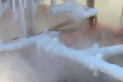 Ice on tubing when supply nitrogen to process, Container with liquid nitrogen, lot of vapour, cool ice on tube in industry jobs. Royalty Free Stock Images